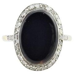 18 Karat Yellow and White Gold Onyx and Diamond Ring