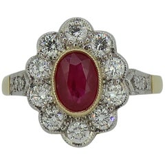 18 Karat Yellow and White Gold Oval Ruby and Diamond Art Deco Style Cluster Ring