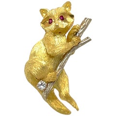 18 Karat Yellow and White Gold Raccoon Brooch with Ruby and Diamond Accents