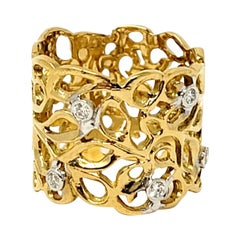 18 Karat Yellow and White Gold Wide Scroll Motif Wide Band Ring with Diamonds