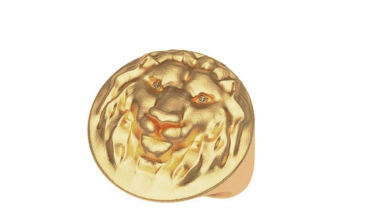 Tiffany designer, Thomas Kurilla created this  18k yellow  Gold Lion Diamond Lion Head Signet Ring . Matte finished and hand sculpted.  Diamonds added for the eyes to make it come alive!   Made to order , Please allow 3.5 weeks delivery. Custom