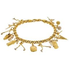 18 Karat Yellow Gold 13 Charm Vintage Link Bracelet
