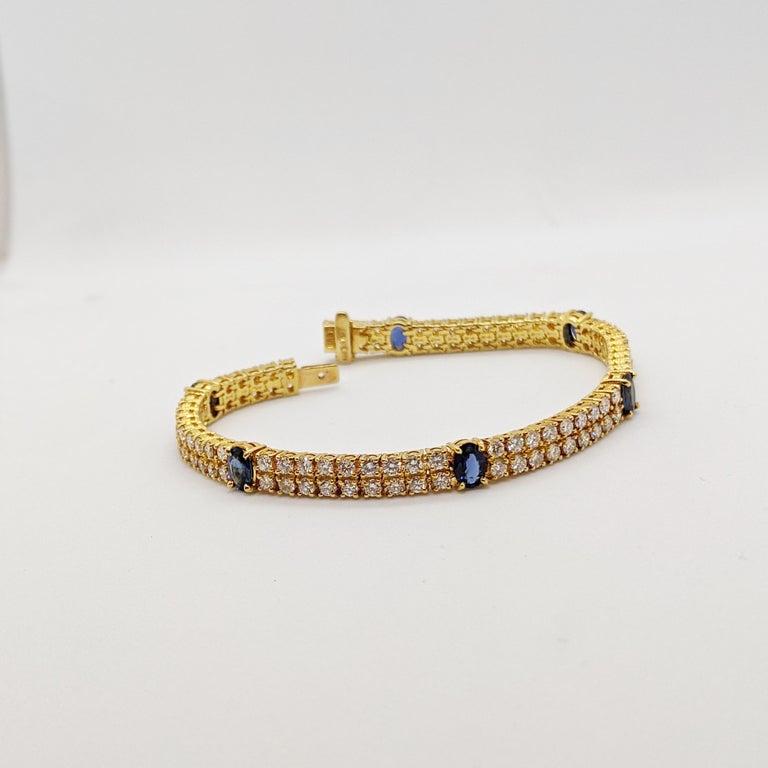 Retro 18 Karat Yellow Gold, 2-Row Diamond Bracelet with 3.19 Carat Oval Blue Sapphires For Sale
