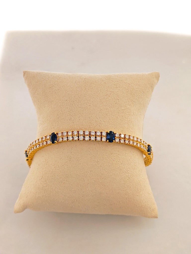 Oval Cut 18 Karat Yellow Gold, 2-Row Diamond Bracelet with 3.19 Carat Oval Blue Sapphires For Sale
