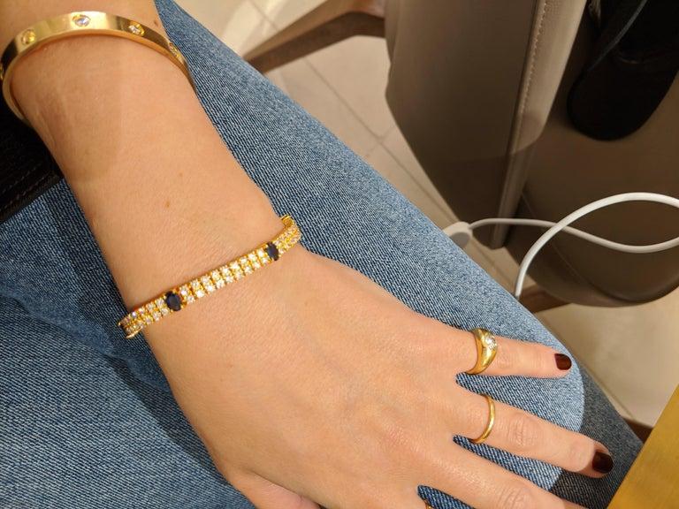 18 Karat Yellow Gold, 2-Row Diamond Bracelet with 3.19 Carat Oval Blue Sapphires For Sale 1