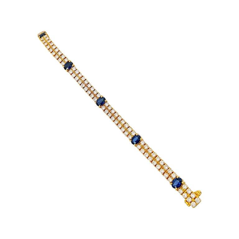 18 Karat Yellow Gold, 2-Row Diamond Bracelet with 3.19 Carat Oval Blue Sapphires For Sale