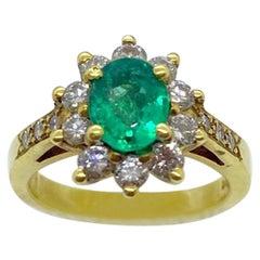 18 Karat Yellow Gold, .86 Carat Oval Emerald Ring with .75 Carat Diamonds
