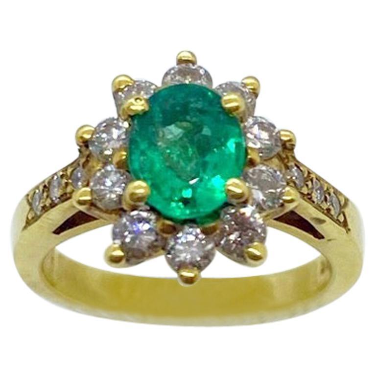 18 Karat Yellow Gold, .86 Carat Oval Emerald Ring with .75 Carat Diamonds For Sale