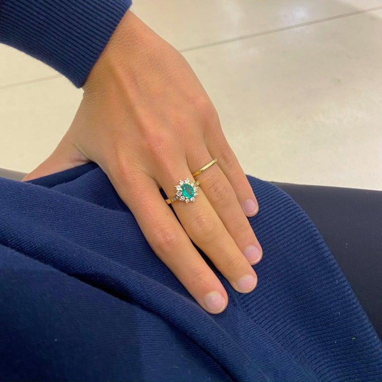 Retro 18 Karat Yellow Gold, .86 Carat Oval Emerald Ring with .75 Carat Diamonds For Sale