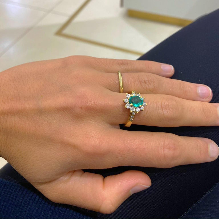 Oval Cut 18 Karat Yellow Gold, .86 Carat Oval Emerald Ring with .75 Carat Diamonds For Sale