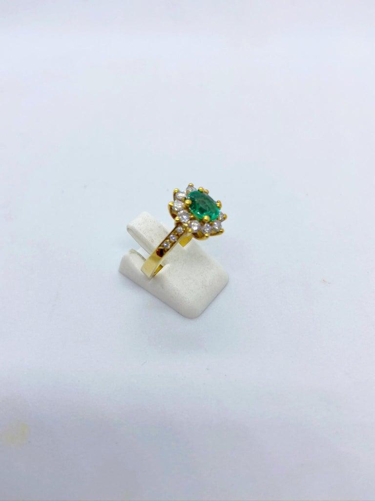 18 Karat Yellow Gold, .86 Carat Oval Emerald Ring with .75 Carat Diamonds For Sale 1