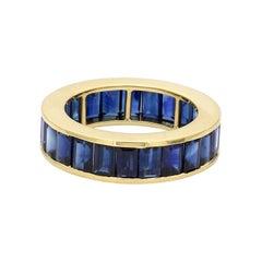 18 Karat Yellow Gold 8.95 Carat Emerald-Cut Sapphire Eternity Band Ring