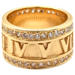 18 Karat Yellow Gold and 1.36 Carat Round Diamond Roman Numeral Band Ring