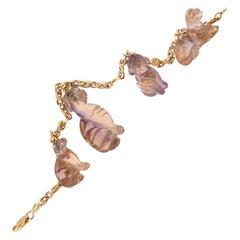 18 Karat Yellow Gold and Amethyst Charm Bracelet