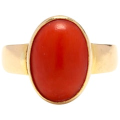 18 Karat Yellow Gold and Bezel Set Coral Solitaire Ring