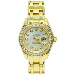 18 Karat Yellow Gold and Diamond Rolex 1995 Pearlmaster Mother of Pearl Dial