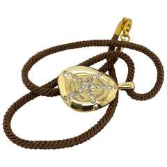 18 Karat Yellow Gold and Diamond Taffin Pebble Pendant and Cord