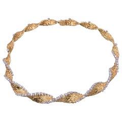 18 Karat Yellow Gold and Diamond Textured Spiral Necklace by Cartier, circa 1965