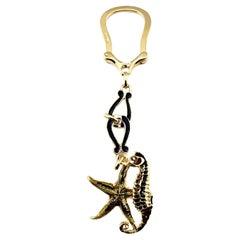 18 Karat Yellow Gold and Enamel Starfish and Seahorse Keychain