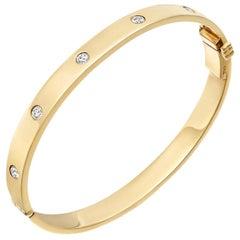 18 Karat Yellow Gold and Five Diamond Hinged Bangle