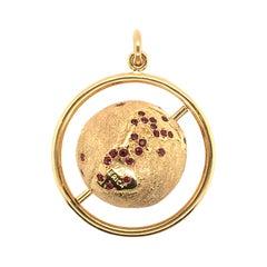 18 Karat Yellow Gold and Ruby Globe Pendant