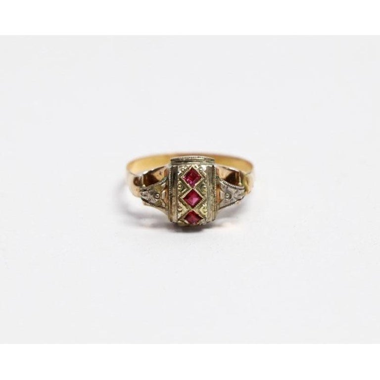 18 Karat Yellow Gold and Silver Ring with 3 Rubies  - Materials & Techniques: Yellow Gold, 833 Silver and Rubies - Date the piece was created: 1938-1985 - Dimensions: Measure 19 - Weight: 2.8 grams (0.10 oz) - Origin: Portugal - Hallmarks of all