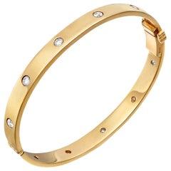 18 Karat Yellow Gold and Ten Diamond Hinged Bangle