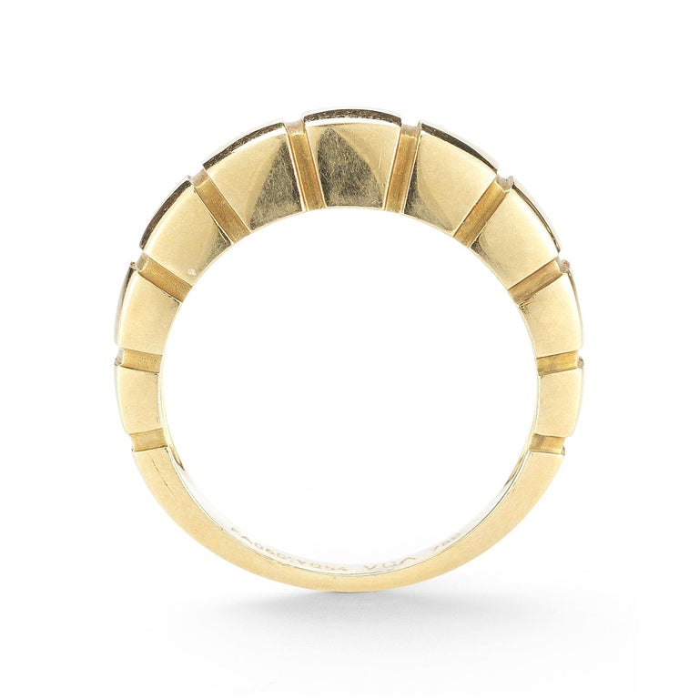 Stack or wear alone! This 18 karat yellow gold Van Cleef & Arpels band style ring is banded in curved cubic sections, signed and numbered VCA FA0501YG54, width 5.5mm. Ring size 7-1/4.
