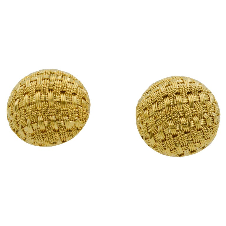 These charming pair of earrings display an adorable basket weave design in 18k yellow gold with a clip back. It has a textured feel that bring a unique look to any outfit.
