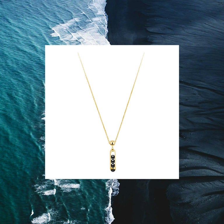This unisex Melody pendant necklace combines perfect hand carved black Onyx beads that roll within their 18 karat gold. Gold award winning Melody collection is a clever design solution.  Each piece incorporates a unique movement mechanism so that