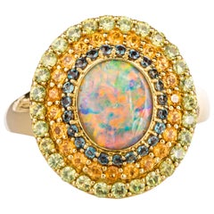 18 Karat Yellow Gold Black Opal Ring with Alexandrite, and Garnet Triple Halo