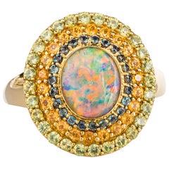 18 Karat Yellow Gold Black Opal Ring with Alexandrite, and Garnet Triple Halo