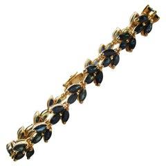 18 Karat Yellow Gold Blue Sapphire Line Bracelet