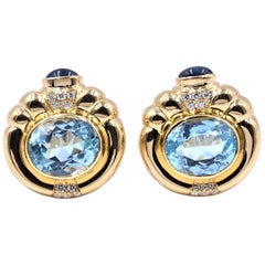 18 Karat Yellow Gold Blue Topaz, Diamond, and Sapphire Ornate Earrings
