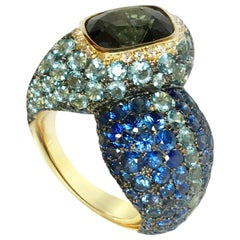 18 Karat Yellow Gold Bluish Green Spinel Blue Sapphires Aqua and Diamond Ring
