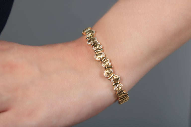 A perfect addition, this unique gold bracelet is set using yellow gold and white diamonds bound together forming an innovative look. The sophisticated design is timeless and absolutely compelling. Its beaded appearance and make it especially