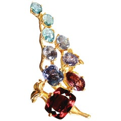 18 Karat Yellow Gold Brooch with Sapphires, and Paraiba Tourmalines