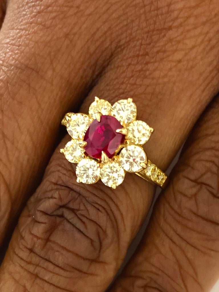 Fine 18K Yellow fold Ring, set with a Red Burma Ruby 1.04 carats and 14 Diamonds 1.47 carats.  We design and manufacture our jewelry in our workshop, located in New York City's diamond district.