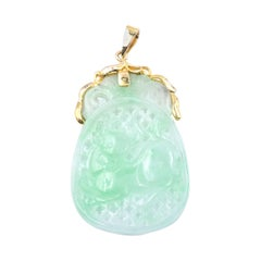 18 Karat Yellow Gold Carved Jade Pendant