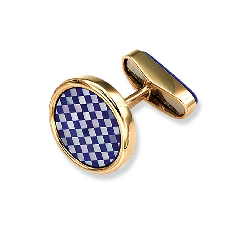 Created by George Gero, Renowned worldwide for luxurious men's cuff-links, comes these classic round cuff links which are set in 18 karat yellow gold with a checkerboard pattern of Lapis Lazuli and Mother-of-pearl.  Collapsible back inlaid with