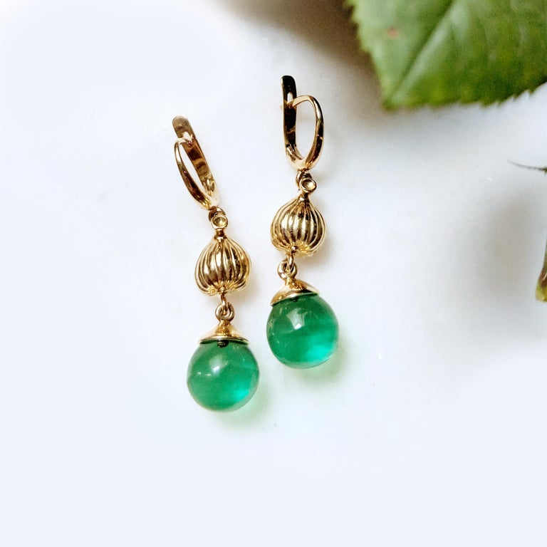 18 Karat yellow gold Fig Fruits cocktail earrings with the cabochon green quartz drops are designed by the oil painter Polya Medvedeva. These earrings by the artist were featured in Vogue UA autumn 2018 review.   These earrings fit best to the