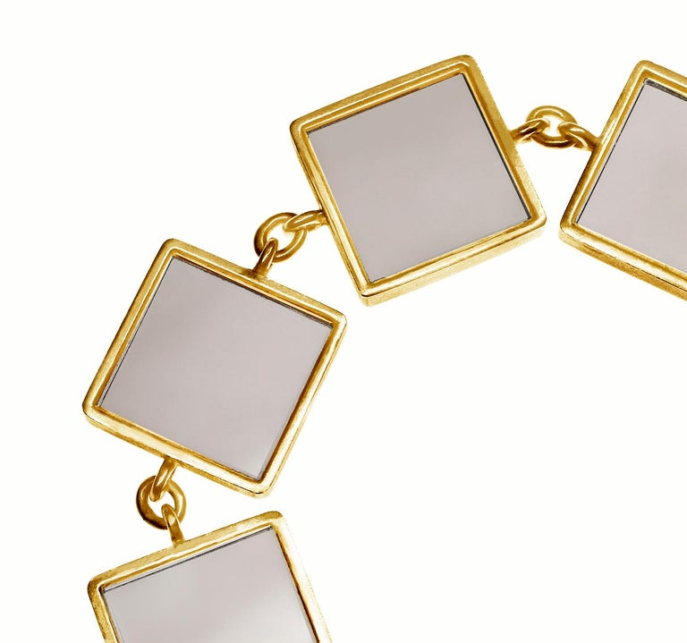 This designer jewellery bracelet is in 18 Karat yellow gold with seven 15x15x3 mm smoky quartzes. The Ink collection was featured in Harper's Bazaar UA and Vogue UA published issues.  The bracelet gives tender and chic light, because of the gold and