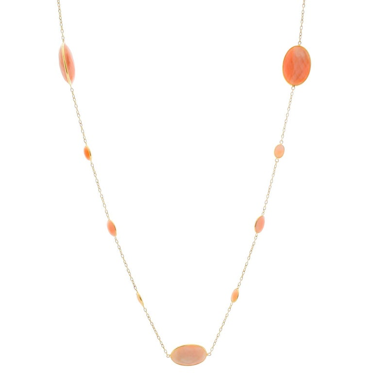 18K Yellow Gold Coral Necklace - This beautiful coral necklace measures 19 inches and features various oval sizes. There are tiny circle links in 18k yellow gold separating each coral piece. New with DeMesy box.