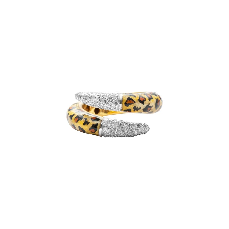 18 Karat Yellow Gold Diamond And Enamel Ring  Exquisitely crafted this beautiful ring is a perfect example of the fusion of enamel, diamonds and gold. The gorgeous animal print enamel work, and the white diamonds fuse together effortlessly to bring