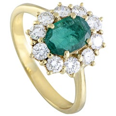 18 Karat Yellow Gold Diamond and Oval Emerald Ring