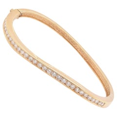18 Karat Yellow Gold Diamond Channel Set Bangle Bracelet