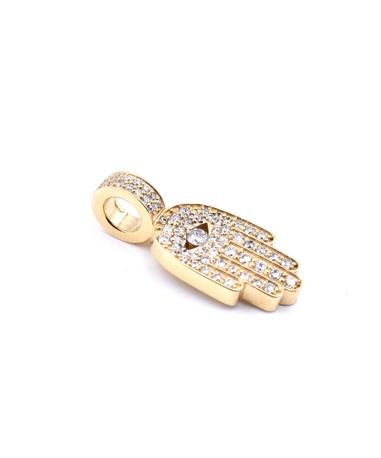 Designer: custom  Material: 18K yellow gold Diamonds: 69 round cut = .75cttw Color: G Clarity: VS Dimensions: pendant measures 25 X 10.25mm Weight: 5.89 grams