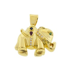 18 Karat Yellow Gold Diamond Ruby Emerald Elephant Pendant