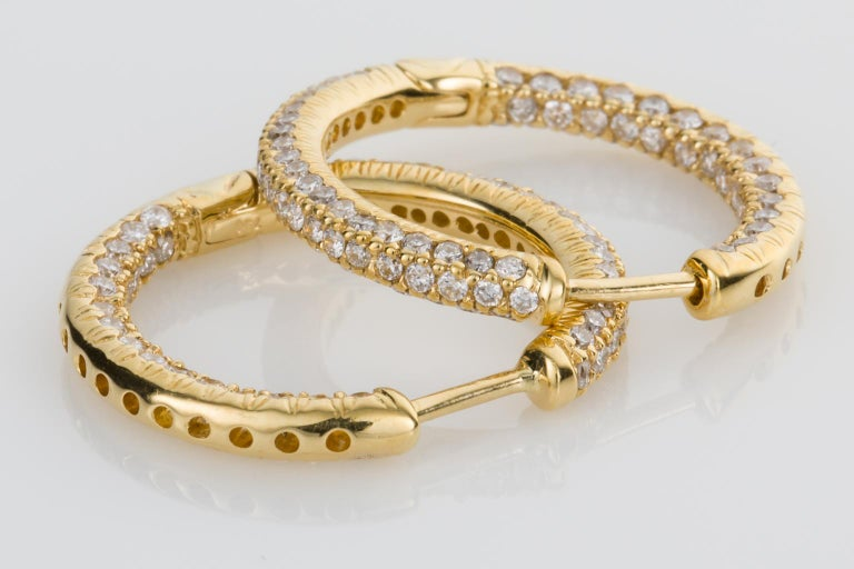 A jewellery staple in every wardrobe, the classic gold hoop earring. These are so much more than just hoops though, set with 204 brilliant cut white diamonds weighing a total of 1.00ct. The diamonds are also set into the back and each side of the