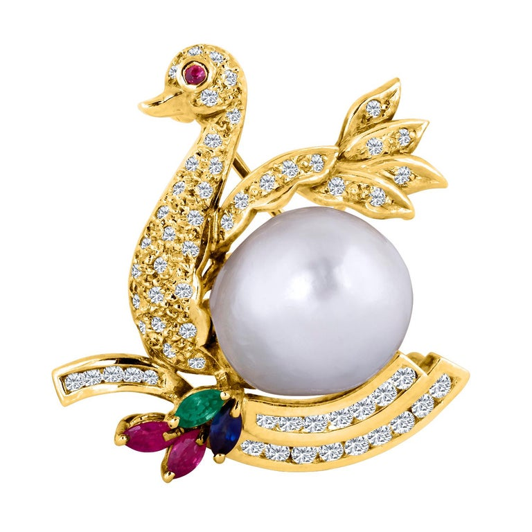 18 Karat Yellow Gold Diamond Swan Brooch with a South Sea Pearl Belly For Sale